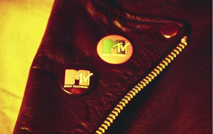 MTV badges on the lapel of a leather jacket