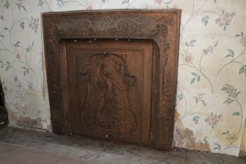 Close-up of dining room fireplace. This one may have to be moved.