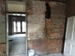 Existing kitchen, looking into the living/dining. One of the only surprises we came across is this wall...we thought it had to stay. Now we think it probably has to come down (or undergo major repair).