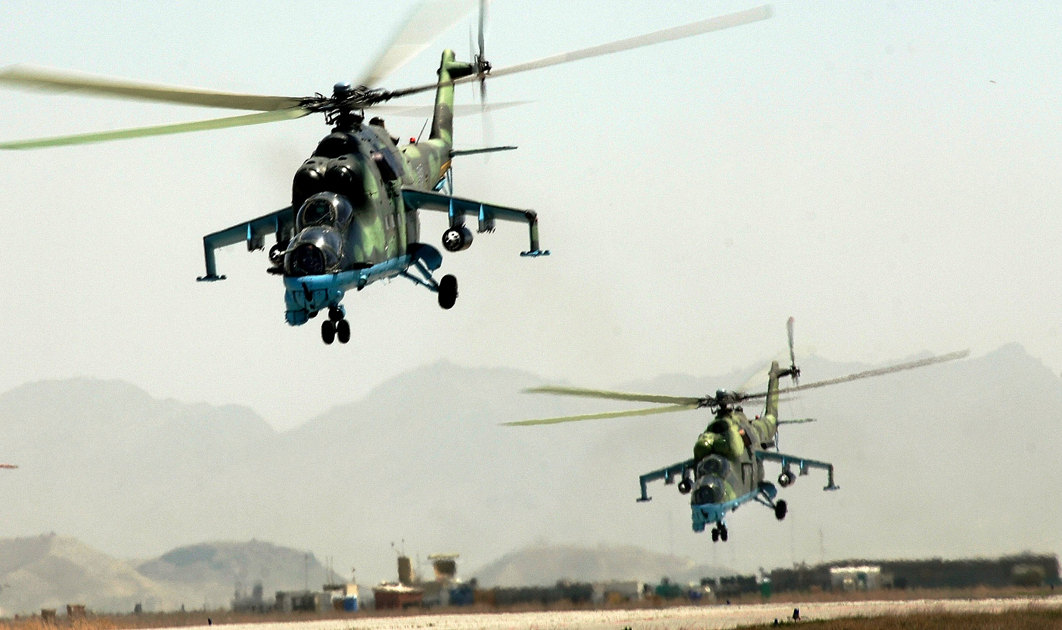 Kabul, Afghanistan -- Afghan National Air Corp MI-35 helicopters take off in a formation practice for the aerial parade in the upcoming Afghan National Day in Kabul. Air Force mentors assigned to Defense Reform Directorate Air Division under Combined Security Transition Command - Afghanistan provide guidance to soldiers with the Maintenance Operations Group for the ANAC. (U.S. Air Force photo by Tech. Sgt. Cecilio M. Ricardo Jr.)