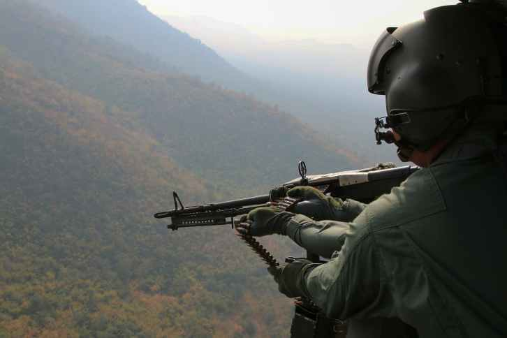 aerial photography of person holding machine gun during daytime
