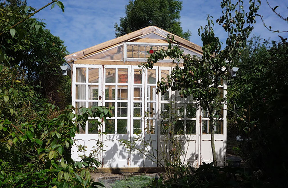 Greenhouse made from old windows and pallets