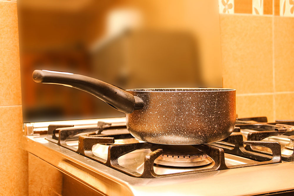Boiling water as a nontoxic weed killer
