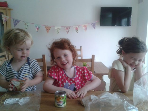 office mum post: three kids baking