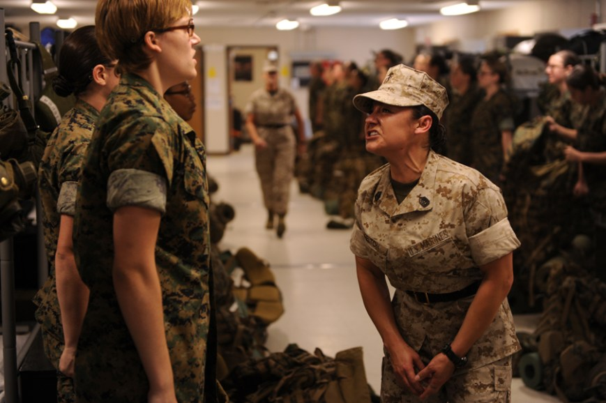 At pickup, a female sergeant instructor screams at a female candidate