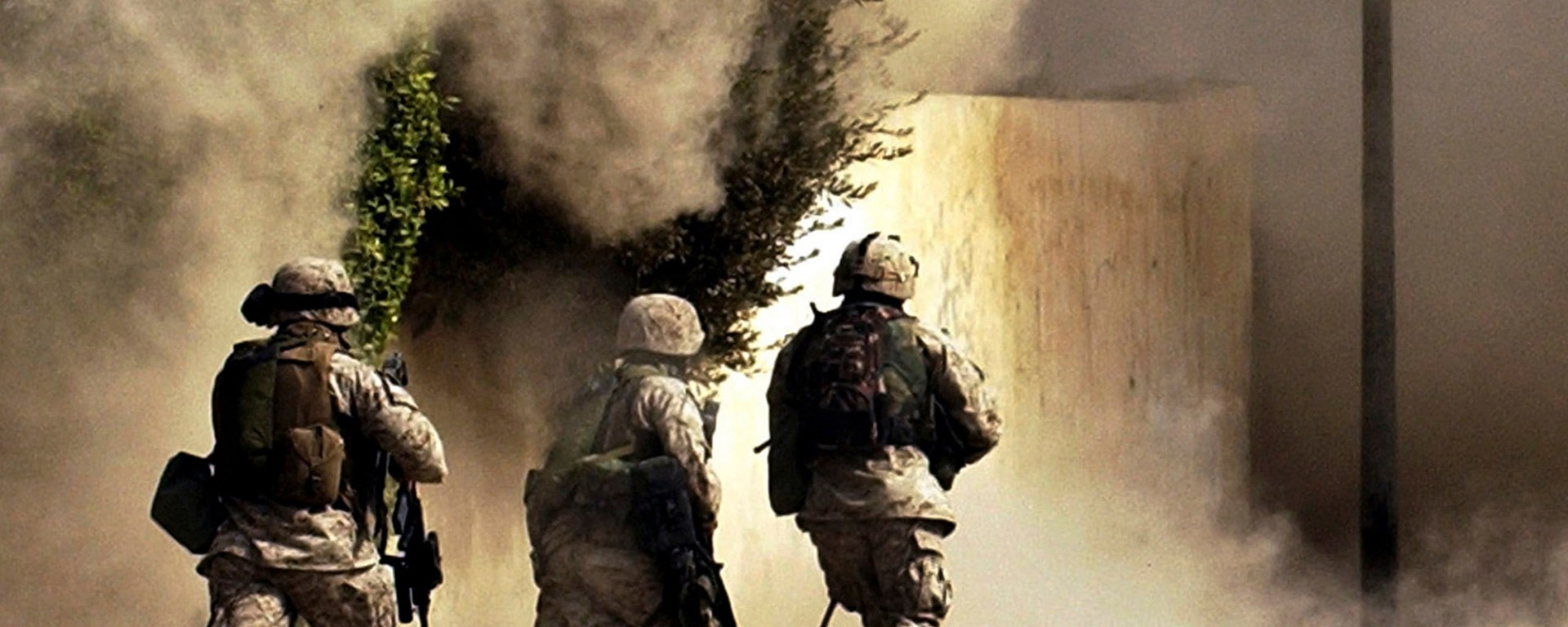 Oct. 26, 2004 U.S. Marines from the 2nd Battalion, 5th Marine Regiment, run to a building after detonating explosives to open a gate during a mission in Ramadi in Anbar province, Iraq.