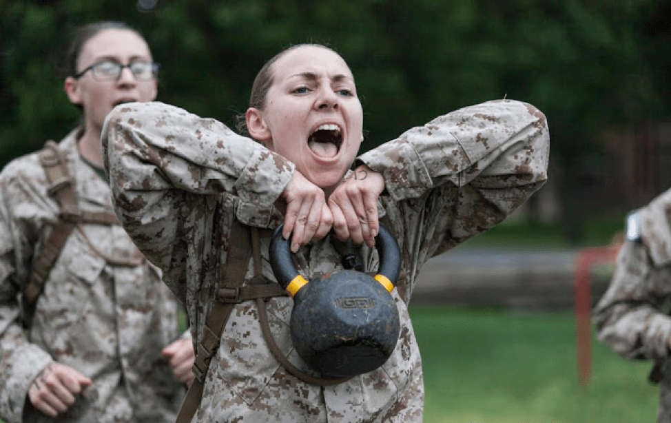 female ocs candidate with kettlebell
