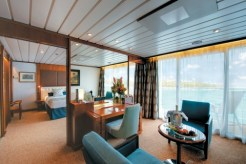 Paul Gauguin cruise ship balcony stateroom desk area