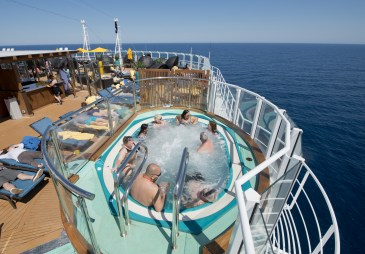 Guests aboard the Carnival Horizon relax in Serenity, an adults-only area of the cruise liner. Photo by Andy Newman/Carnival Cruise Line