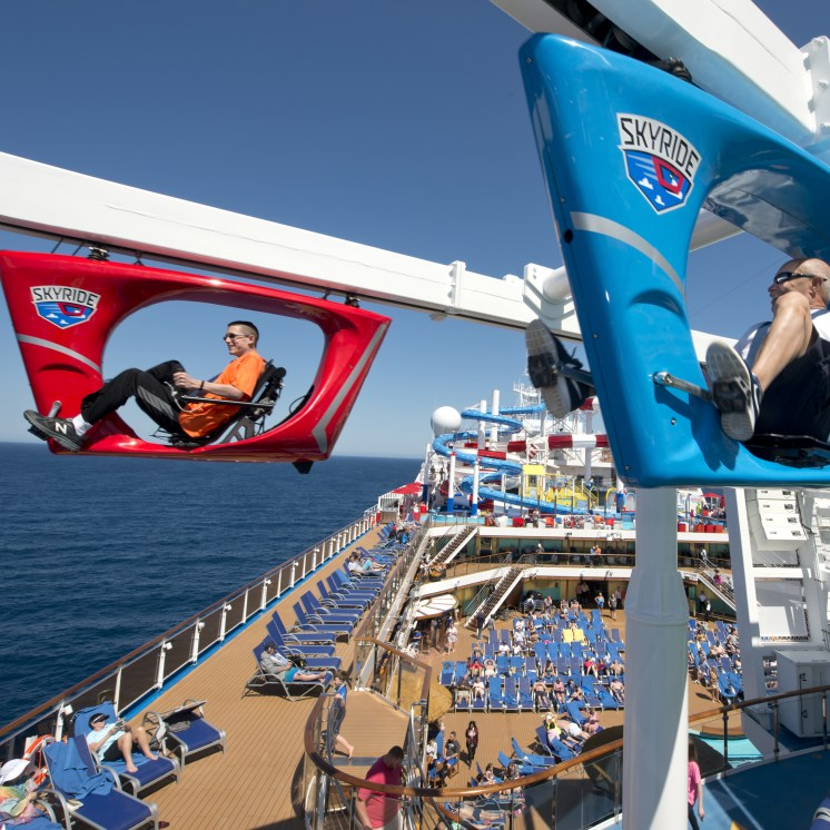 Guests aboard the Carnival Horizon pedal a SkyRide vehicle around much of the 133,500-ton cruise liner. Photo by Andy Newman/Carnival Cruise Line