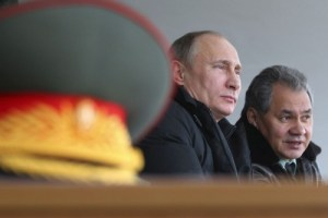 Russian president Vladimir Putin and his defense minister General Sergey Shoygu observe military exercises in Anapa on the Black Sea, March 29, 2013