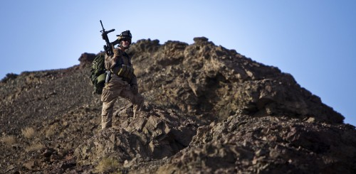A U.S. Marine provides overwatch to a group of geologists searching for rare earth minerals in Khan Neshin Ghar, Afghanistan on Aug. 16, 2010. Marine Corps photo