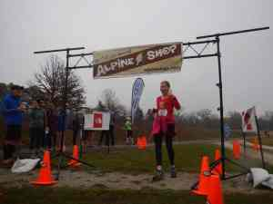 Juanita Buescher crosses the finish line at Alpine Shop's Shaw Bloom 10K/20K Trail Run presented by The North Face.
