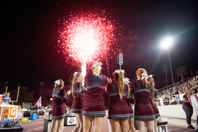 University of Redlands cheerleaders watch the fireworks during Homecoming 2017.