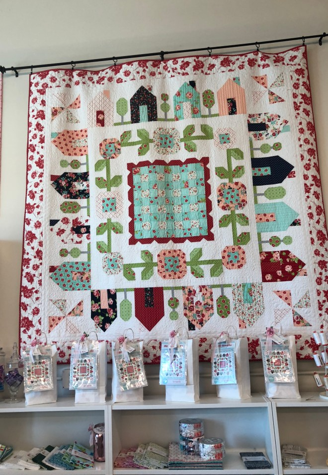 A quilt on display at Shabby Rose Quilting Cottage
