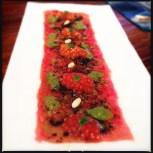 Tuna carpaccio with tomato and finely crushed black nori (dried seaweed)