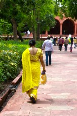 Lady in colorful saree strolling through the gardens