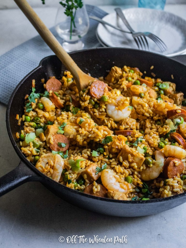Side shot gluten free paella with spoon