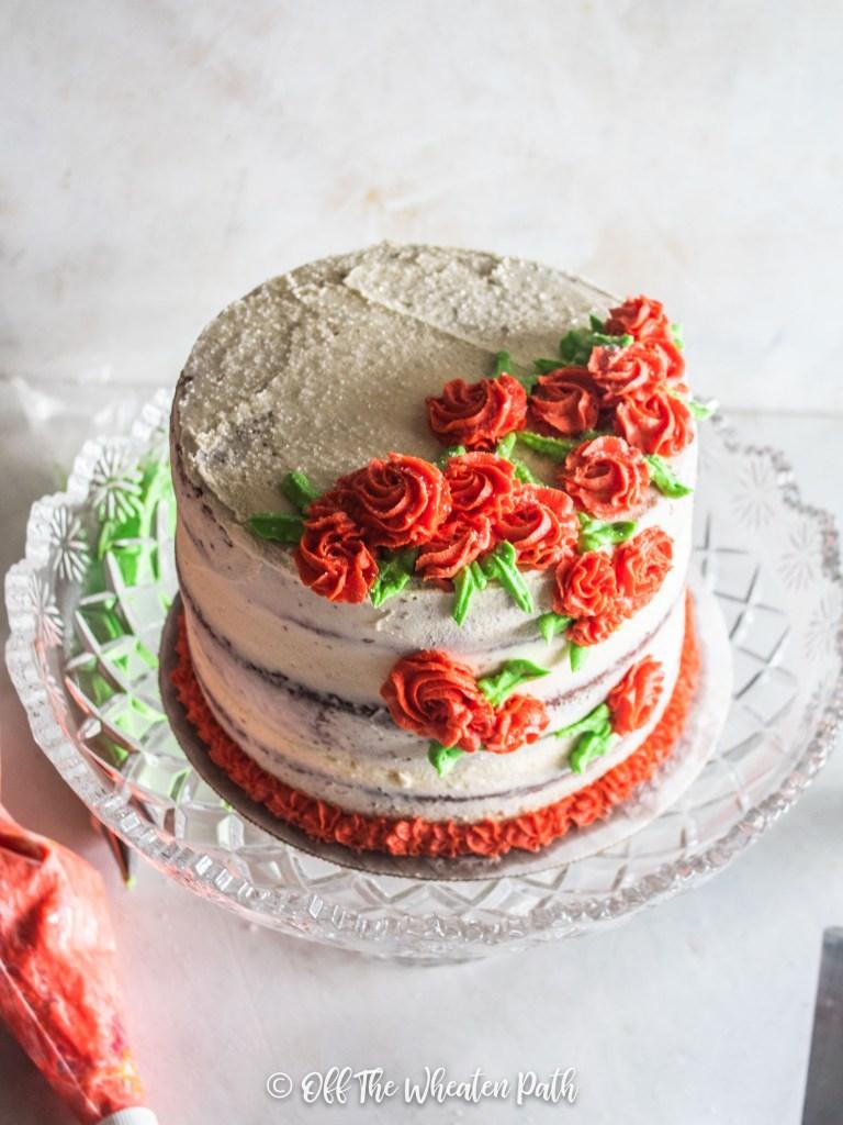Flowers decorating gluten free red velvet cake