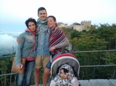 Patrizia, Vito, Arianna, and Bianca with the castle.