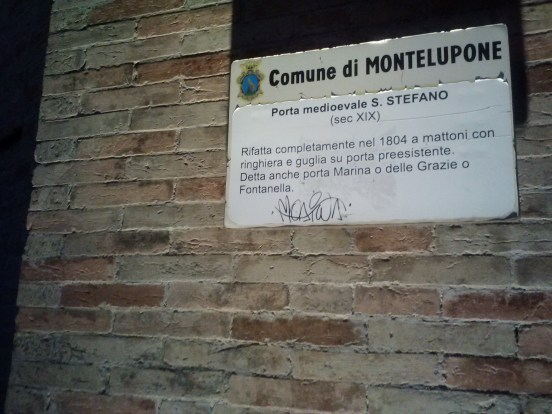A sign talking about the town of Montelupone.