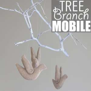 Tree Branch Mobile by Of Houses and Trees | Super charming and whimsical DIY tree branch mobile made with a spray-painted poplar branch, stuffed birds and fishing line.