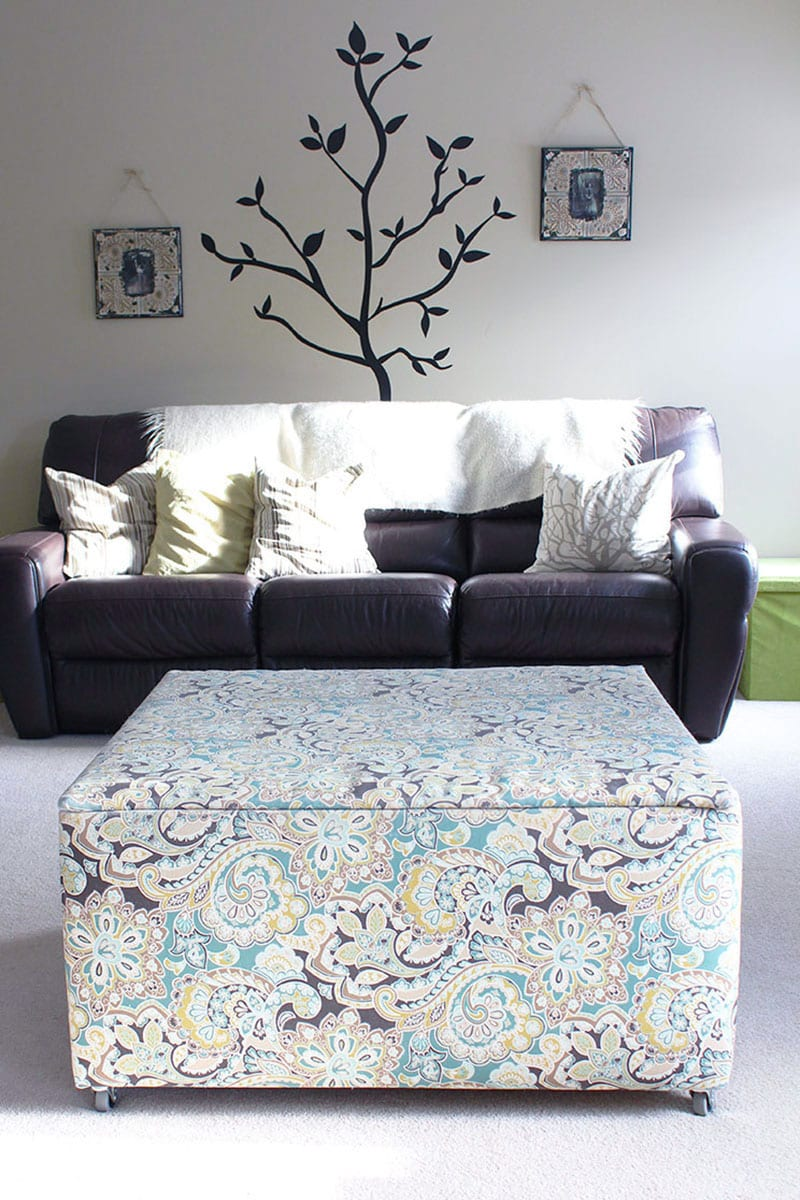 A wood ottoman toy box covered in a graphic floral print.