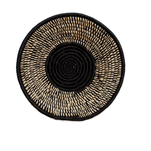 Whether your decor style is Boho, Coastal - even Minimalist - there's a set of woven basket wall decor out there with your name on it! And you can start with the Black Spotted Wall Bowl from ethical brand KAZI.
