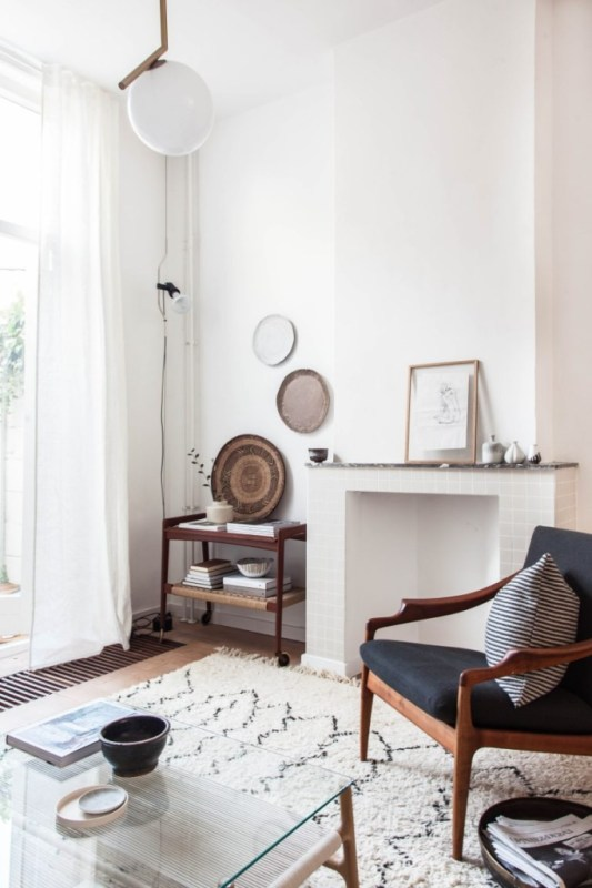 Want to incorporate woven basket wall decor into your minimalist home? Try simply leaning a basket on a side table. It's what Avenue Lifestyle did and it looks both casual - and cool.