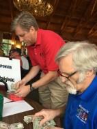 Inside - Ed Radginski & Rotarian counting 50 50 money