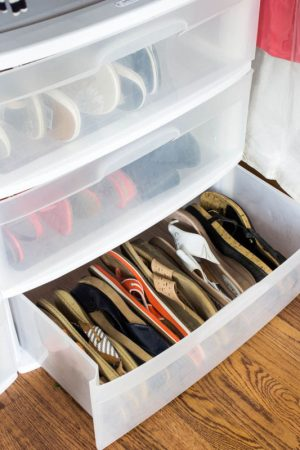 A plastic storage container is perfect for storage sandals and other shoes.