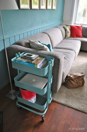 Instead of a living room side table, opt for a mobile storage cart.