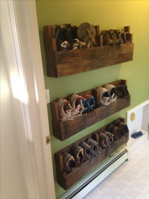 Make a shoe rack out of recycled pallet pieces for your front door entryway.