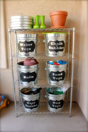 Organize toys outside using tubs and chalboard labels.