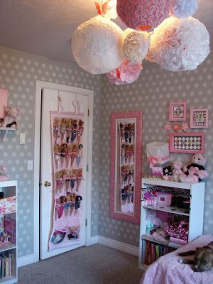 Use a shoe organizer to store barbie dolls.
