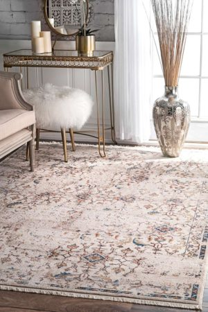This vintage rug is perfect! I love the distressed look with the gold room accents.
