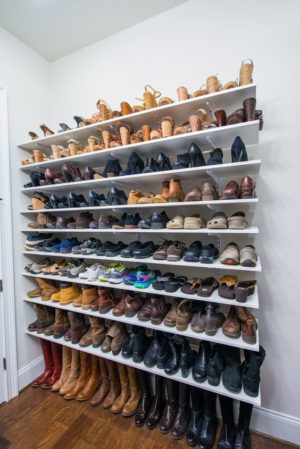 Install adjustable shelving on your bedroom wall for a store-like display of your shoes.