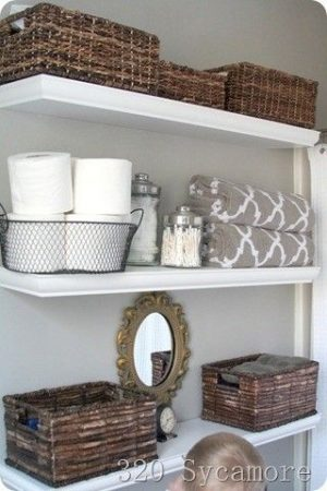 Install shelves and use rustic decor baskets to organize your bathroom.