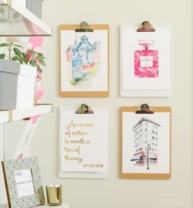 Use clipboards to hang printable art in your home office. It really adds to the work aesthetic!