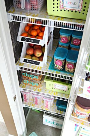 Organize your pantry using dollar store bins and chalkboard labels.