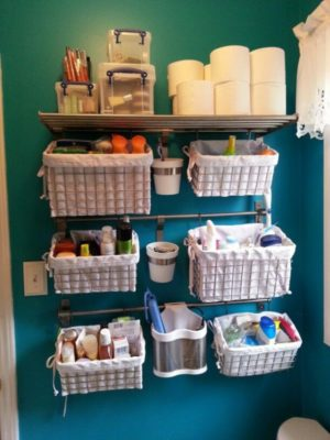Install towel bars in your bathroom and hang baskets on them for storage.
