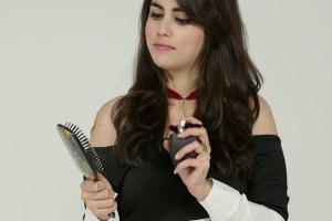 Spray your favorite perfume on your hair brush and never directly on your hair.