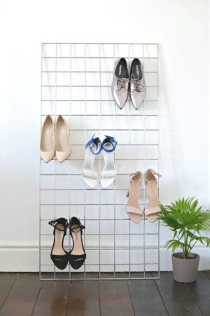 Use a simple metal grid to organize and display shoes in your room.