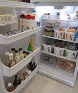 Use dollar store bins to store food and organize your refrigerator.