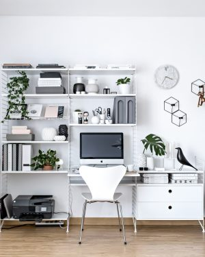 Use metal shelving to organize your office and give it a sleek and clean aesthetic.