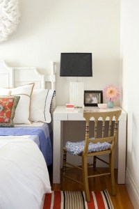 Make your beside table also your desk to save space in a small bedroom or apartment.