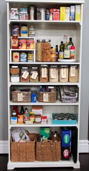 Use a simple bookshelf as a standalone pantry in a small kitchen.