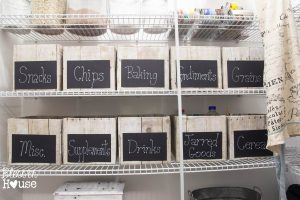 Use chalkboard labels on bins to organize your pantry.