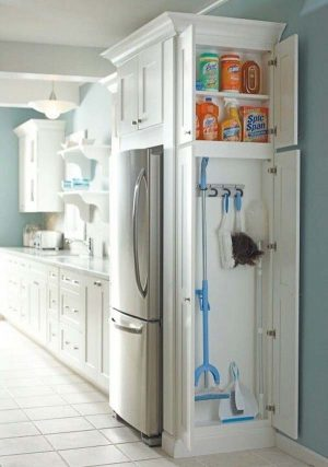Add a cabinet to the side of your fridge to store your cleaning supplies. Repin if you love this!