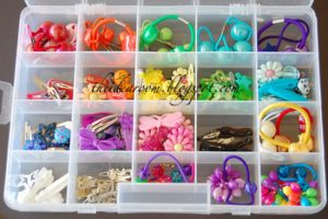 Use a dollar store craft box to store hair accessories. Repin for later!
